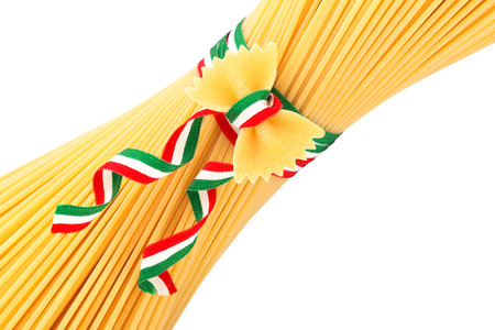 bunch of spaghetti and farfalle tied by a tricolour strip photo
