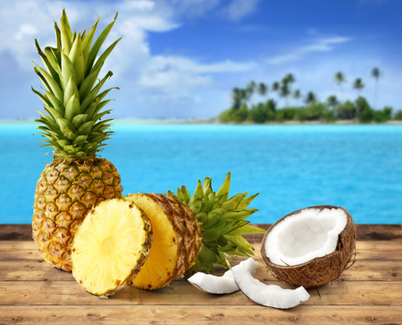 fresh pineapple and coconut in tropical landscape Stockfoto