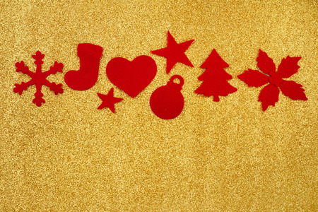 felt Christmas decorations on gold glitter background photo