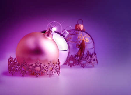 christmas bauble and decorative stripes on violet background photo