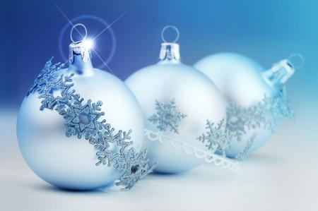 christmas bauble and decorative stripes on azure background photo