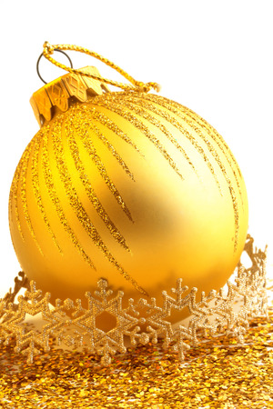 golden christmas ball isolated on white background photo