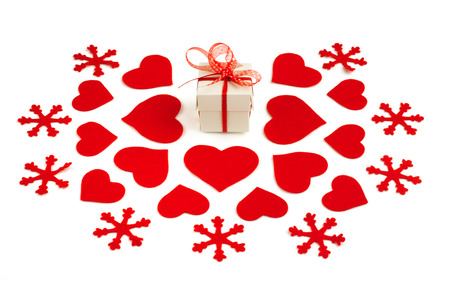 small gift box and felt decorations on white background photo