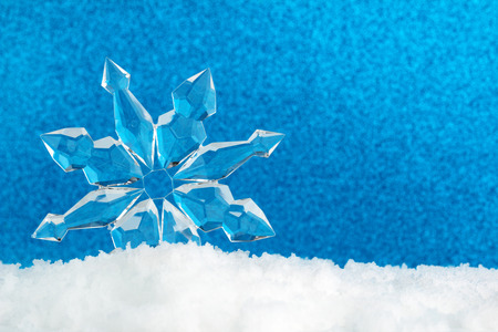 ice crystal on snow in blue background
