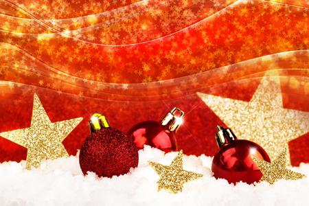 christmas balls and glitter stars on snow Stockfoto