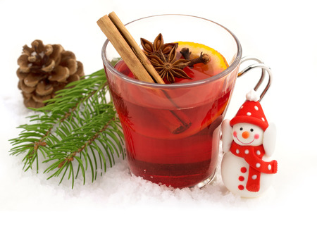 red tea: mulled wine and a small snowman in the snow