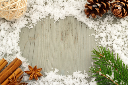 decorations and snow on a wooden table photo