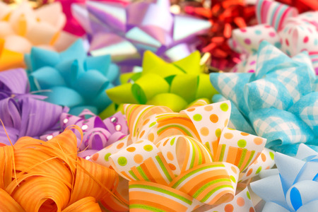 heap of gift bows, colored and decorated photo