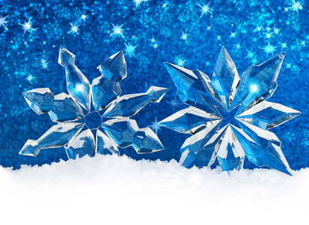 iceflower: ice crystals on snow in blue background