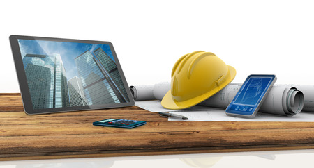 construction project: tablet, smartphone, safety helmet and blueprints on wooden table