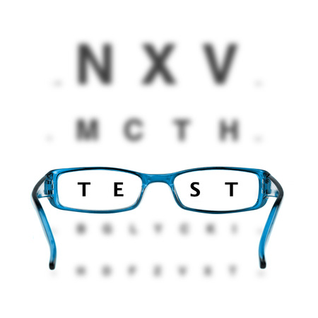 blue eyeglasses and eyechart on white background