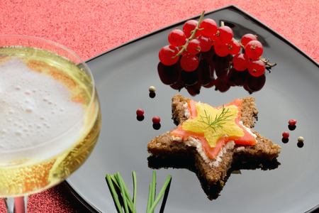 smoked salmon canapé and glass of champagne photo