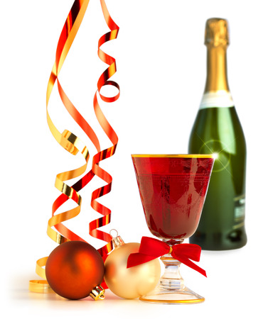 red goblet, christmas balls and satin ribbons on white background photo