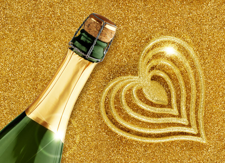champagne and heart-shaped decoration on glitter gold background photo