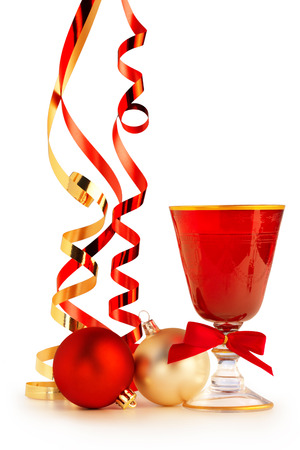 goblet: red goblet, christmas baubles and satin ribbons on white background Stock Photo