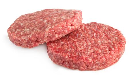 two hamburger patties isolated on white background