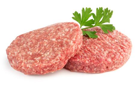caked: hamburger patties and parsley isolated on white background