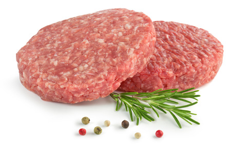 caked: two raw hamburger, rosemary and pepper on white background