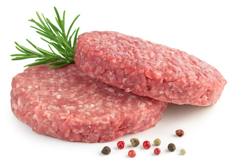 minced beef: two raw hamburger, rosemary and pepper on white background