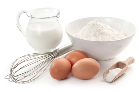 pastries: eggs, flour, milk, sugar and wire whisk Stock Photo
