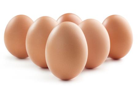 group of six eggs isolated on white background photo