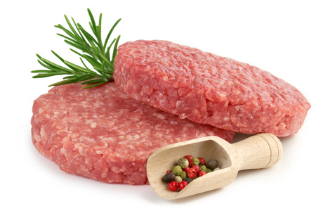 ground beef: raw burgers, rosemary and scoop with pepper