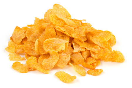 heap of corn flakes isolated on white background Stock Photo - 34795156