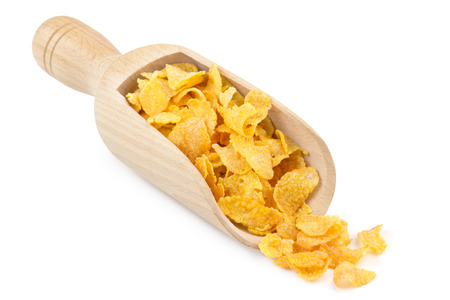 corn flakes in a wooden scoop isolated on white background photo