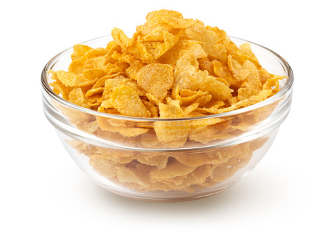corn flakes in a glass bowl isolated on white photo