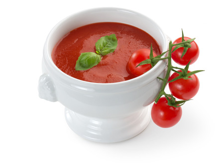 bowl of tomato soup isolated on white background