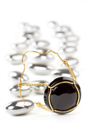 close up of a champagne cork among silver sugared almonds photo