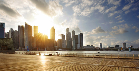 Central business district of Singapore and promenade at sunset Stock fotó