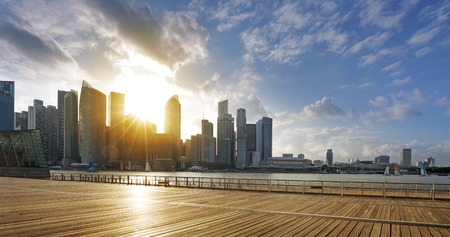 skyline at sunrise: Central business district of Singapore and promenade at sunset Editorial