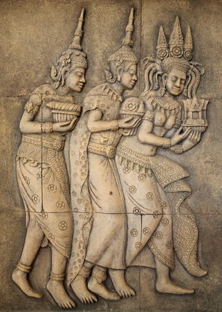 bas: bas-relief of Khmer civilization in a sandstone wall