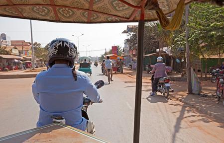 tuk: tuk tuk driver in a busy street