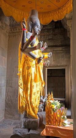 vishnu: stone statue of Vishnu inside a Khmer temple