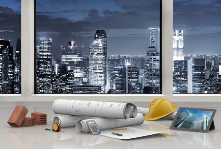 house blueprint: work tools in architects office with city skyline Stock Photo