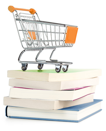 shopping cart on top of a stack of books photo