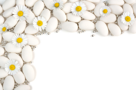 sugarplum: white with silver dragees spheres and daisies on white background