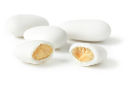 sugared: close up of a sugar-coated almond on white background