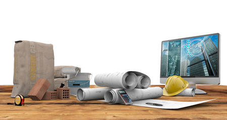 나무 테이블에 청사진, 벽돌, pc와 시멘트 가방 스톡 콘텐츠