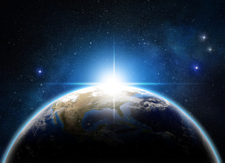 future space: sunrise over the earth in outer space