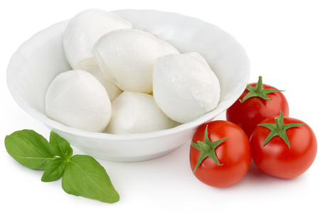 mozzarella cheese, cherry tomatoes and basil leaf photo