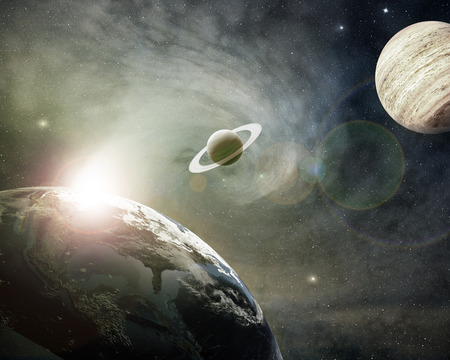 outer space: planet earth, saturn and jupiter in a cosmic cloud Stock Photo
