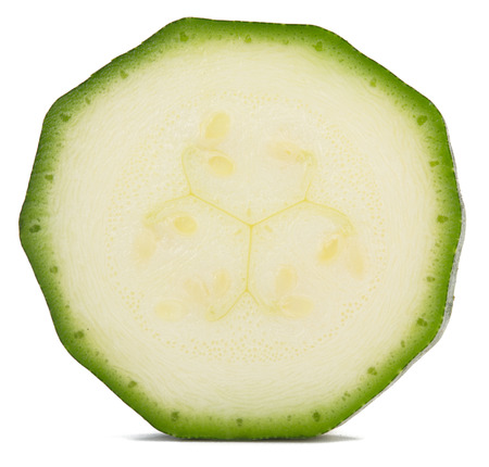 one slice of zucchini isolated on white Reklamní fotografie