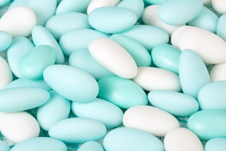 sugared: heap of azure and white sugared almonds