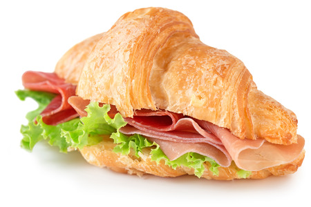 croissant with parma ham and lettuce isolated on white photo