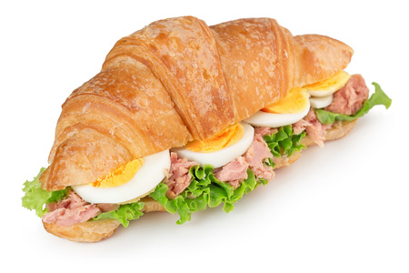 croissant sandwich with egg and tuna isolated on white