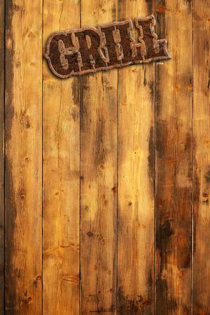 """나무 벽에 걸려있는 패 """"그릴"""""""