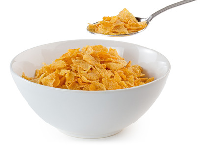 cornflakes: bowl of cornflakes with a spoon on white background Stock Photo